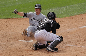 DENVER, CO - JUNE 30:  Gordon Beckham #15 of the Chicago White Sox slides home with an insurance run ahead of the tag by catcher Matt Pagnozzi #15 of the Colorado Rockies on a two RBI game winning single by Juan Pierre of the White Sox in the 10th inning