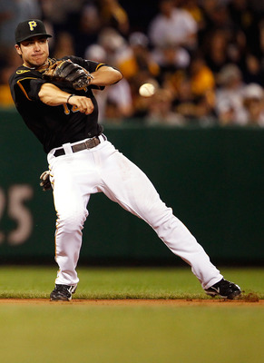 PITTSBURGH - JULY 05:  Chase d'Arnaud #12 of the Pittsburgh Pirates throws to second base against the Houston Astros during the game on July 5, 2011 at PNC Park in Pittsburgh, Pennsylvania.  (Photo by Jared Wickerham/Getty Images)