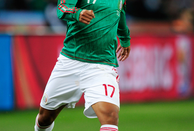 JOHANNESBURG, SOUTH AFRICA - JUNE 27:  Giovani Dos Santos of Mexico runs with the ball during the 2010 FIFA World Cup South Africa Round of Sixteen match between Argentina and Mexico at Soccer City Stadium on June 27, 2010 in Johannesburg, South Africa.
