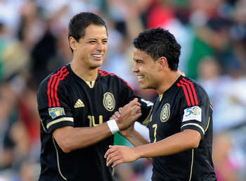 PASADENA, CA - JUNE 25:  Pablo Barrera #7 of Mexico celebrates his goal with Javier 'Chicharito' Hernandez #14 against the United States during the 2011 CONCACAF Gold Cup Championship at the Rose Bowl on June 25, 2011 in Pasadena, California.  (Photo by K
