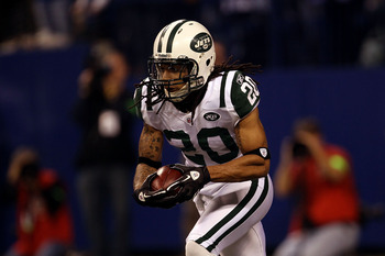 INDIANAPOLIS, IN - JANUARY 08:  Kyle Wilson #20 of the New York Jets returns a kickoff against the Indianapolis Colts during their 2011 AFC wild card playoff game at Lucas Oil Stadium on January 8, 2011 in Indianapolis, Indiana. The Jets won 17-16.  (Phot