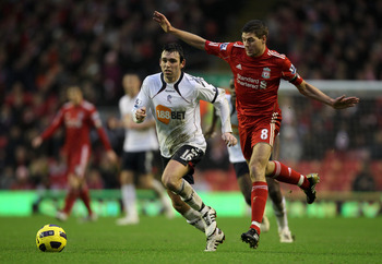 LIVERPOOL, ENGLAND - JANUARY 01:  Steven Gerrard of Liverpool competes for the ball with Mark Davies of Bolton Wanderers during the Barclays Premier League match between Liverpool and Bolton Wanderers at Anfield on January 1, 2011 in Liverpool, England.