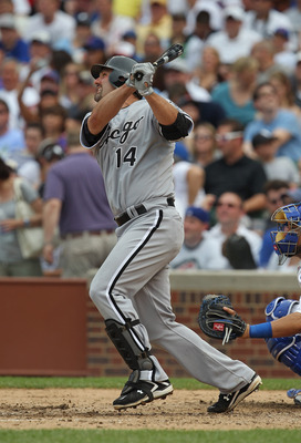 CHICAGO, IL - JULY 01:  Paul Konerko #14 of the Chicago White Sox hits the ball against the Chicago Cubs at Wrigley Field on July 1, 2011 in Chicago, Illinois. The White Sox defeated the Cubs 6-4.  (Photo by Jonathan Daniel/Getty Images)