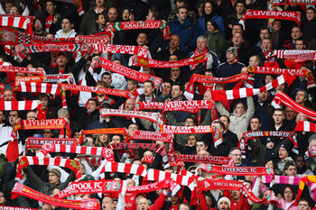 LIVERPOOL, UNITED KINGDOM - JANUARY 26:  Liverpool fans in the cop hold scarfs during singing of you'll never Walk Alone during the FA Cup 4th round sponsored by E.ON match between Liverpool and Havant & Waterlooville at Anfield on January 26, 2008 in Liv