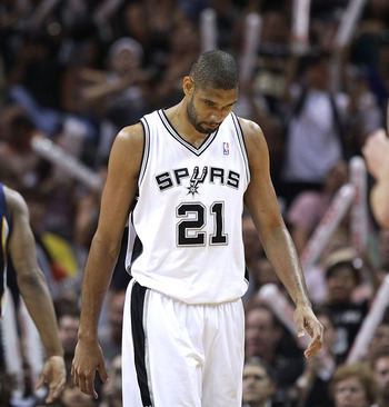 SAN ANTONIO, TX - APRIL 27:  Tim Duncan #21 of the San Antionio Spurs looks on against the Memphis Grizzlies in Game Five of the Western Conference Quarterfinals in the 2011 NBA Playoffs on April 27, 2011 at AT&T Center in San Antonio, Texas. NOTE TO USER