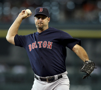 HOUSTON - JULY 01:  Pitcher Tim Wakefield #49 of the Boston Red Soz throws against the Houston Astros at Minute Maid Park on July 1, 2011 in Houston, Texas.  (Photo by Bob Levey/Getty Images)
