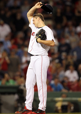 BOSTON, MA - JULY 05:  Jonathan Papelbon #58 of the Boston Red Sox wipes his face in the ninth inning against the Toronto Blue Jays on July 5, 2011 at Feway Park in Boston, Massachusetts. Papelbon gave up a two run homer in the inning. (Photo by Elsa/Gett