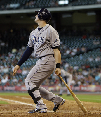 HOUSTON - JUNE 26:  Evan Longoria #3 of the Tampa Bay Rays watches the ball leave the park after hitting a three-run home run in the ninth inning against the Houston Astros at Minute Maid Park on June 26, 2011 in Houston, Texas. Tampa Bay won 14-10.  (Pho