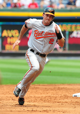 ATLANTA - JULY 3: J. J. Hardy #2 of the Baltimore Orioles rounds second base against the Atlanta Braves at Turner Field on July 3, 2011 in Atlanta, Georgia. (Photo by Scott Cunningham/Getty Images)