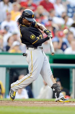 WASHINGTON, DC - JULY 02:  Andrew McCutchen #22 of the Pittsburgh Pirates hits a double in the third inning against the Washington Nationals at Nationals Park on July 2, 2011 in Washington, DC.  (Photo by Greg Fiume/Getty Images)
