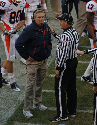 CHICAGO - NOVEMBER 20: Head coach Ron Zook of the Illinois Fighting Illini talks to a referee during a game against the Northwestern Wildcats played at Wrigley Field on November 20, 2010 in Chicago, Illinois. (Photo by Jonathan Daniel/Getty Images)