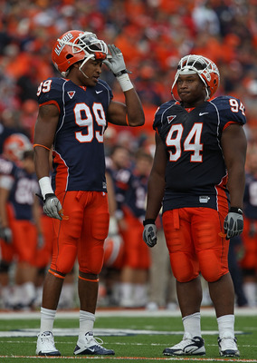 CHAMPAIGN, IL - OCTOBER 02: Michael Buchanan #99 and Akeem Spence #94 of the Illinois Fighting Illini wait during a replay time-out against the Ohio State Buckeyes at Memorial Stadium on October 2, 2010 in Champaign, Illinois. Ohio State defeated Illinois