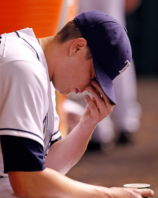ST. PETERSBURG, FL - JUNE 27:  Pitcher Jeremy Hellickson #48 of the Tampa Bay Rays reacts in the dugout against the Cincinnati Reds during the game at Tropicana Field on June 27, 2011 in St. Petersburg, Florida.  (Photo by J. Meric/Getty Images)