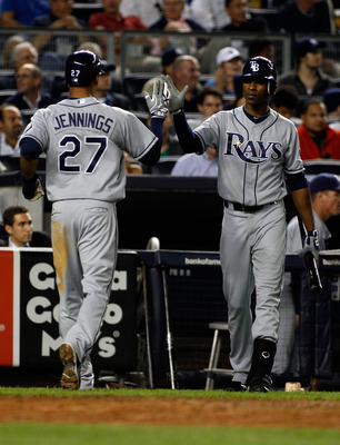 NEW YORK - SEPTEMBER 23:  Desmond Jennings #27 of the Tampa Bay Rays is congratulated by teammate B.J. Upton #2 after scoring on Dan Johnson's sacrifice fly in the seventh -inning against the New York Yankees  on September 23, 2010 at Yankee Stadium in th