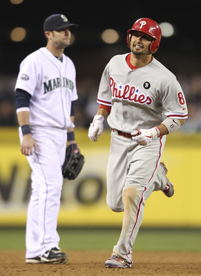 SEATTLE - JUNE 18:  Shane Victorino #8 of the Philadelphia Phillies rounds the bases past third baseman Adam Kennedy #4 after hitting a two-run homer in the ninth inning against the Seattle Mariners at Safeco Field on June 18, 2011 in Seattle, Washington.