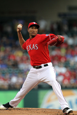 ARLINGTON, TX - JULY 01:  Alexi Ogando #41 of the Texas Rangers throws against the Florida Marlins at Rangers Ballpark in Arlington on July 1, 2011 in Arlington, Texas.  (Photo by Ronald Martinez/Getty Images)