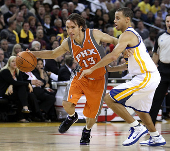 OAKLAND, CA - DECEMBER 02:  Steve Nash #13 of the Phoenix Suns drives on Stephen Curry #30 of the Golden State Warriors at Oracle Arena on December 2, 2010 in Oakland, California. NOTE TO USER: User expressly acknowledges and agrees that, by downloading a