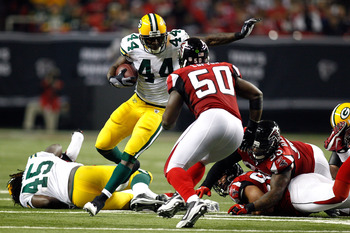 ATLANTA, GA - JANUARY 15:  James Starks #44 of the Green Bay Packers runs the ball against Curtis Lofton #50 of the Atlanta Falcons during their 2011 NFC divisional playoff game at Georgia Dome on January 15, 2011 in Atlanta, Georgia.  (Photo by Chris Gra