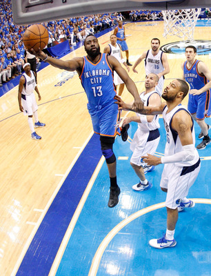 DALLAS, TX - MAY 25:  James Harden #13 of the Oklahoma City Thunder goes up for a shot against Tyson Chandler #6 of the Dallas Mavericks in the first half in Game Five of the Western Conference Finals during the 2011 NBA Playoffs at American Airlines Cent