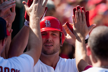 ST. LOUIS - SEPTEMBER 5: Matt Holliday #7 of the St. Louis Cardinals is congratulated by teammates after hitting a three-run home run against the Cincinnati Reds at Busch Stadium on September 5, 2010 in St. Louis, Missouri.  The Cardinals beat the Reds 4-