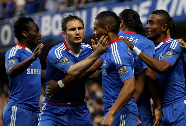 LONDON, ENGLAND - APRIL 20:  Frank Lampard of Chelsea congratulates scorer Florent Malouda with Salomon Kalou (R) during the Barclays Premier League match between Chelsea and Birmingham City at Stamford Bridge on April 20, 2011 in London, England.  (Photo