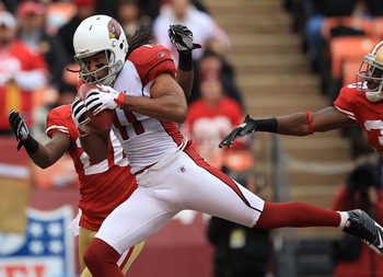 SAN FRANCISCO, CA - JANUARY 2:  Larry Fitzgerald #11 of the Arizona Cardinals catches a touchdown against the San Francisco 49er during an NFL game at Candlestick Park on January 2, 2011 in San Francisco, California.(Photo by Jed Jacobsohn/Getty Images)