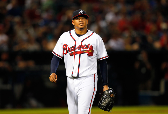 ATLANTA, GA - JUNE 14:  Jair Jurrjens #49 of the Atlanta Braves walks off the field after he was relieved in the sixth inning against the New York Mets at Turner Field on June 14, 2011 in Atlanta, Georgia.  (Photo by Kevin C. Cox/Getty Images)