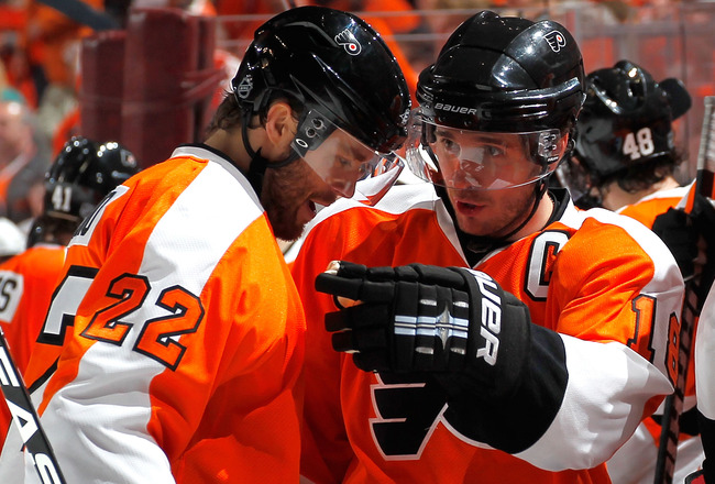 PHILADELPHIA, PA - APRIL 16:  Mike Richards #18 congratulates teammate Ville Leino #22 of the Philadelphia Flyers after Leino scored a goal against the Buffalo Sabres during the second period of Game Two of the Eastern Conference Quarterfinals during the