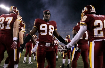 LANDOVER, MD - DECEMBER 21:  Brian Orakpo #98 of the Washington Redskins is introduced before the Redskins take on the Giants at FedEx Field on December 21, 2009 in Landover, Maryland. (Photo by Al Bello/Getty Images)