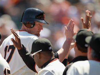 SAN FRANCISCO, CA - JUNE 23:  Aubrey Huff #17 of the San Francisco Giants is congratulated by teammates after he scored in the eighth inning against the Minnesota Twins at AT&T Park on June 23, 2011 in San Francisco, California.  (Photo by Ezra Shaw/Getty