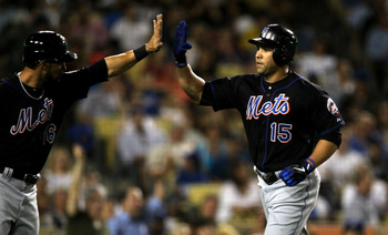 LOS ANGELES, CA - JULY 5:  Carlos Beltran #15 of the New York Mets is greeted by Angel Pagan #16 after both score on Beltran's two run home run in the fifth inning against the Los Angeles Dodgers on July 5, 2011 at Dodger Stadium in Los Angeles, Californi