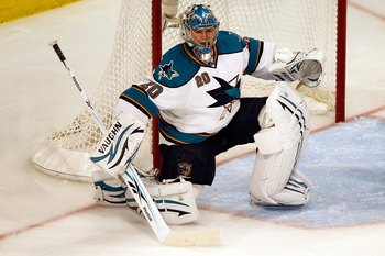 CHICAGO - MAY 23:  Goaltender Evgeni Nabokov #20 of the San Jose Sharks looks on while taking on the Chicago Blackhawks in Game Four of the Western Conference Finals during the 2010 NHL Stanley Cup Playoffs at the United Center on May 23, 2010 in Chicago,
