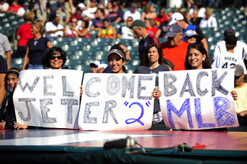 CLEVELAND, OH - JULY 4: Yankees fans hold a sign welcoming Derek Jeter #2 of the New York Yankees back to the lineup prior to the game against the Cleveland Indians at Progressive Field on July 4, 2011 in Cleveland, Ohio. (Photo by Jason Miller/Getty Imag