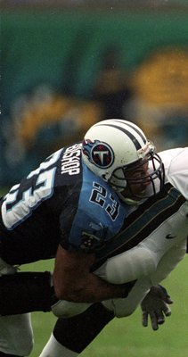26 Sep 1999:  Kyle Brady #80 of the Jacksonville Jaguars gets tackled by Blaine Bishop #23 of the Tennessee Titans during the game at the Alltel Stadium in Jacksonville, Florida. The Titans defeated the Jaguars 20-19. Mandatory Credit: Eliot J. Schechter