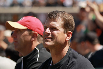 SAN FRANCISCO, CA - JUNE 08:  San Francisco 49ers head coach Jim Harbaugh watches the San Francisco Giants play the Washington Nationals at AT&T Park on June 8, 2011 in San Francisco, California.  (Photo by Ezra Shaw/Getty Images)