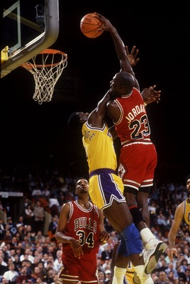 Michael Jordan of the Chicago Bulls makes a basket against the Los Angeles Lakers.  Mandatory Credit: Stephen Dunn/ALLSPORT
