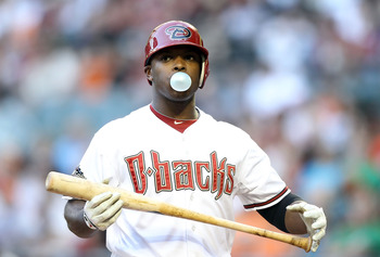 PHOENIX, AZ - JUNE 14:  Justin Upton #10 of the Arizona Diamondbacks reacts as he bats against the San Francisco Giants during the Major League Baseball game at Chase Field on June 14, 2011 in Phoenix, Arizona.  (Photo by Christian Petersen/Getty Images)
