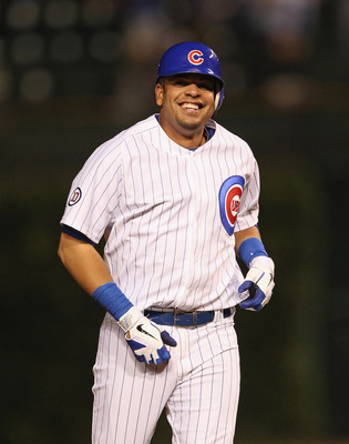 CHICAGO, IL - JUNE 29:  Aramis Ramirez #16 of the Chicago Cubs smiles after getting the game-winning hit as a pinch-hitter in the bottom of the 9th inning against the San Francisco Giants at Wrigley Field on June 29, 2011 in Chicago, Illinois. The Cubs de