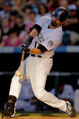 DENVER, CO - JUNE 14:  Todd Helton #17 of the Colorado Rockies singles off of Wade LeBlanc of the San Diego Padres and drives in a run during the fourth inning at Coors Field on June 14, 2011 in Denver, Colorado. (Photo by Justin Edmonds/Getty Images)