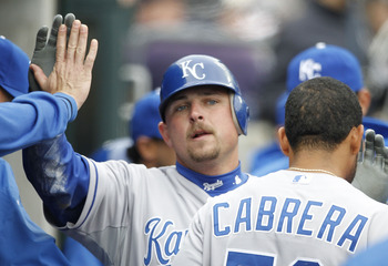 DETROIT - APRIL 09: Billy Butler #16 of the Kansas City Royals is congratulated by his teammates after scoring in the second inning during the game against the Detroit Tigers at Comerica Park on April 9, 2011 in Detroit, Michigan.  (Photo by Leon Halip/Ge