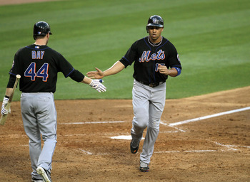 LOS ANGELES, CA - JULY 4:  Carlos Beltran #15 of the New York Mets is greeted after hitting an RBI double, then scoring himself on a Daniel Murphy double, in the sixth inning against the Los Angeles Dodgers on July 4, 2011 at Dodger Stadium in Los Angeles