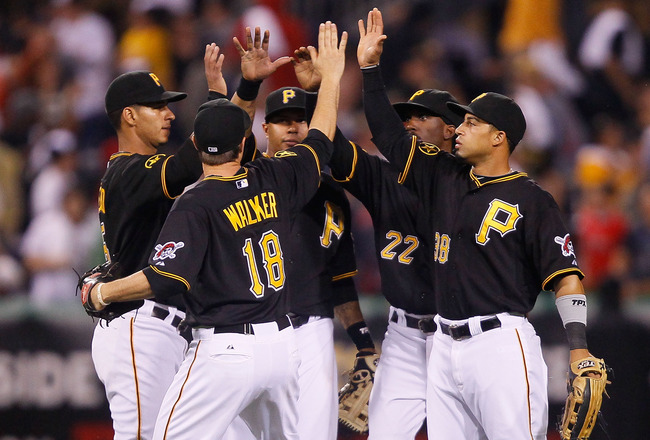 PITTSBURGH - JUNE 24:  Ronny Cedeno #5, Neil Walker #18, Jose Tabata #31, Andrew McCutchen #22, and Xavier Paul #38 of the Pittsburgh Pirates celebrate in center field after their win against the Boston Red Sox on June 24, 2011 at PNC Park in Pittsburgh,