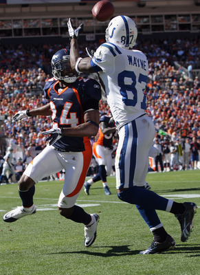 DENVER - SEPTEMBER 26:  Wide receiver Reggie Wayne #87 of the Indianapolis Colts makes a first down reception as Champ Bailey #24 of the Denver Broncos defends at INVESCO Field at Mile High on September 26, 2010 in Denver, Colorado. The Colts defeated the