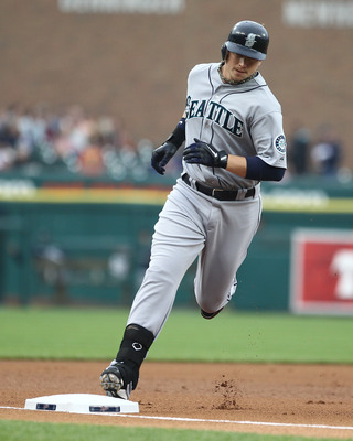 DETROIT, MI - JUNE 10: First Baseman Justin Smoak #17 of the Seattle Mariners touches all the bases after hitting a solo home run in the first inning during a MLB game against the Detroit Tigers at Comerica Park on June 10, 2011 in Detroit, Michigan.  Sea