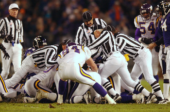 07 Jan 2002: Officials try to get to the bottom of the pile to rule on a fumble recovery as the Baltimore Ravens host the Minnesota Vikings in the second qurter of week 17 NFL action at PSINet Stadium in Baltimore, Maryland. DIGITAL IMAGE. Mandatory Credi