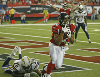 ATLANTA - AUGUST 29:  Wide receiver Eric Weems #14 of the Atlanta Falcons hauls in the game winning touchdown pass from teammate Chris Redman #8 as cornerback Simeon Castille #26 of the San Diego Chargers falls short during the game at the Georgia Dome on