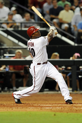PHOENIX, AZ - JUNE 28:  Justin Upton #10 of the Arizona Diamondbacks follows through on a swing against the Cleveland Indians at Chase Field on June 28, 2011 in Phoenix, Arizona. Arizona won 6-4. (Photo by Norm Hall/Getty Images)