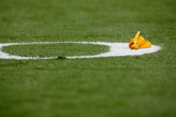 MIAMI - OCTOBER 19: An officials yellow penalty flag thrown on the field during the game between the Miami Dolphins and the Baltimore Ravens at Dolphin Stadium on October 19, 2008 in Miami, Florida. (Photo by Eliot J. Schechter/Getty Images)