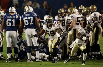 MIAMI GARDENS, FL - FEBRUARY 07:  Malcolm Jenkins #27 and Anthony Hargrove #69 of the New Orleans Saints reacts after a onside kick to start the second half  against the Indianapolis Colts during Super Bowl XLIV on February 7, 2010 at Sun Life Stadium in