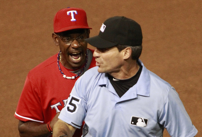 ARLINGTON, TX - JULY 3: Ron Washington #38 of the Texas Rangers is thrown out of the game by umpire Angel Hernandez #55 for a disputed call at first base against the Florida Marlins at Rangers Ballpark in Arlington on July 3, 2011 in Arlington, Texas. (Ph